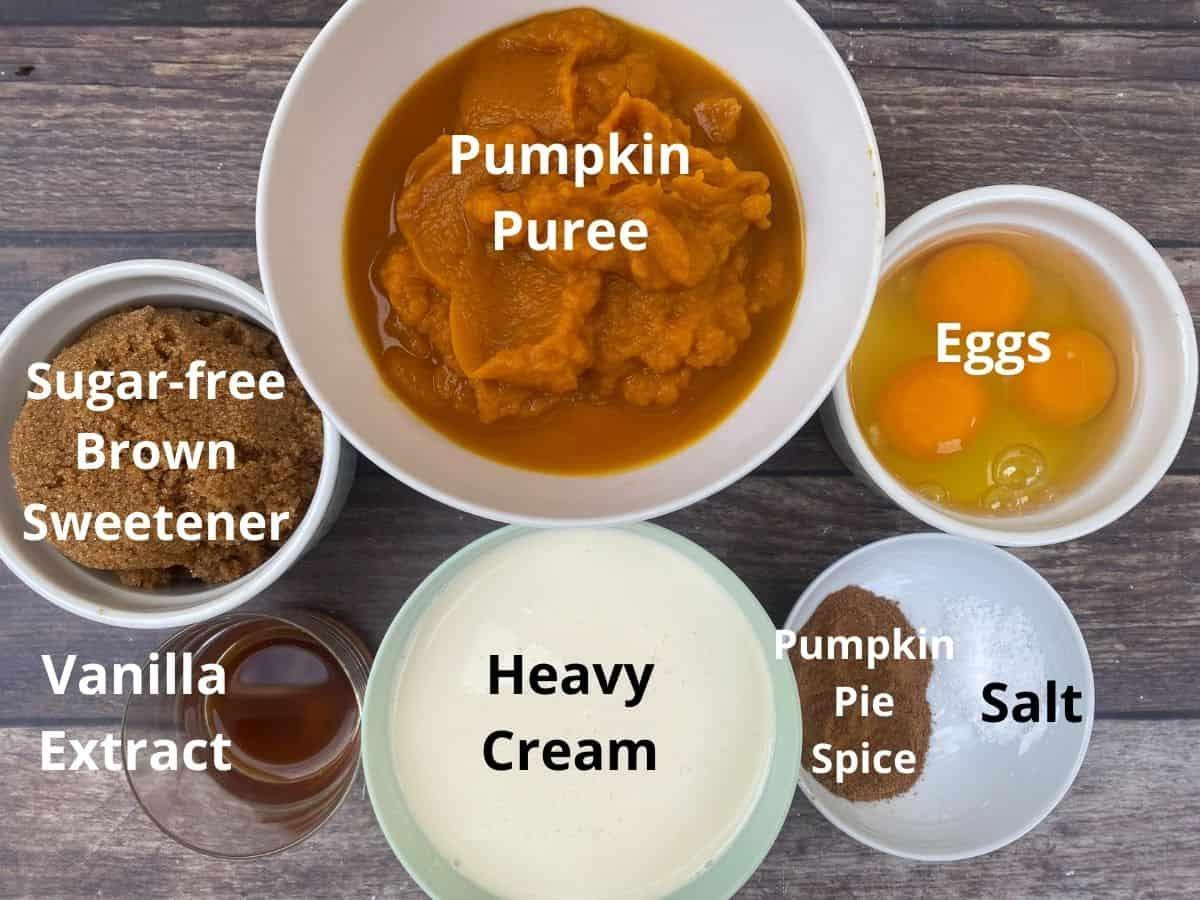 Keto pumpkin pie ingredients in bowls and labeld
