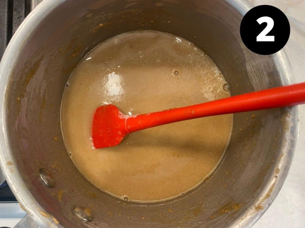 Pan with melted wet ingredients being stirred.