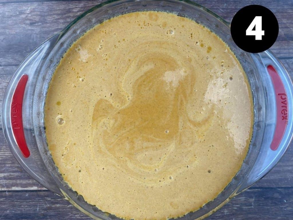 Keto pumpkin pie mix in greased pie dish.
