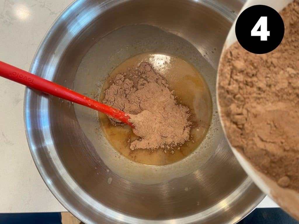 Dry ingredients being combined with wet ingredients in one bowl.