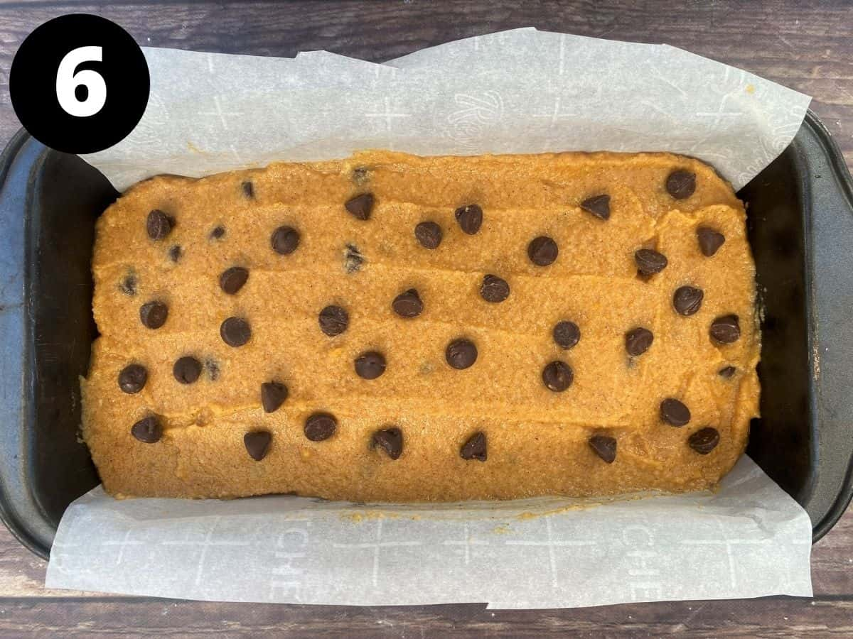 Pumpkin bread batter in parchment lined loaf pan
