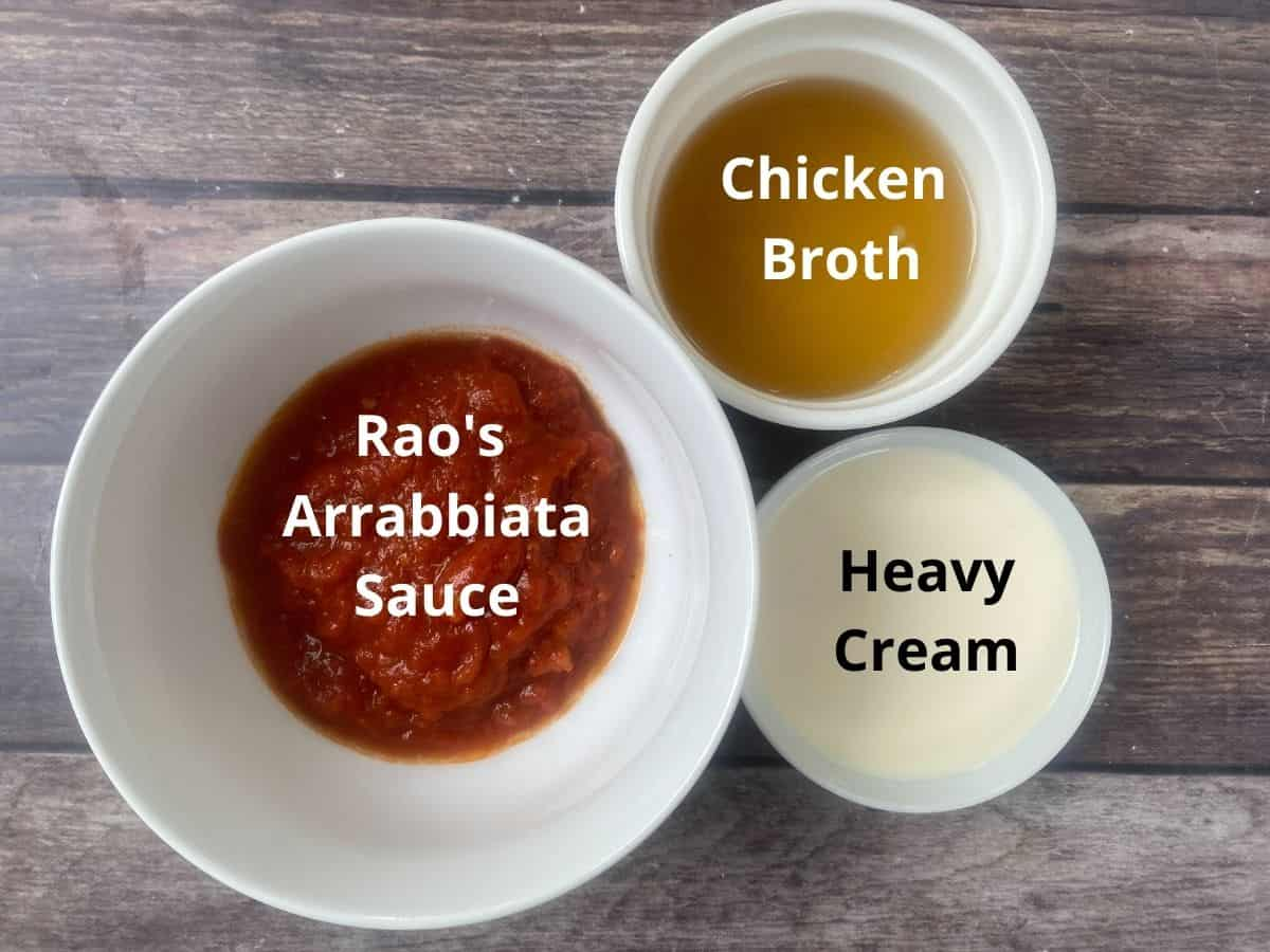 Keto tomato soup ingredients in bowls and labeled.